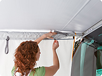 Put the upper ending of the side panel over the awning's arm and close the zipper - ready!e awning's arm and shut the zipper - ready!