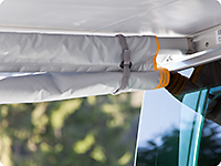 The side panel can also be rolled up and fixed to the awning arm.