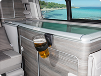 The beer glass fits into the VW T6 California cup holder.