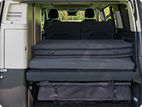 The iXTEND folding bed consists of three parts and can be stowed folded on the rear board of the Mercedes-Benz Marco Polo (2014 –>).
