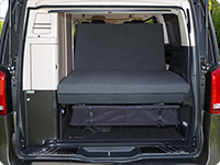 All iXTEND folding beds can be flipped over and folded to the backrest of the 2 seater bench of the Mercedes-Benz Marco Polo in a way that a big storage or lying area is create without gaps.
