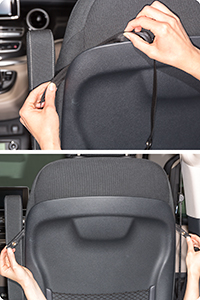 On the sides, a strap made of polyester is hung into the plastic shell of the backrest.