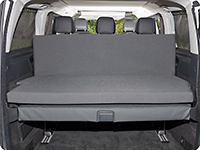 The iXTEND folding bed can be unfolded and leaned against the 3-seater bench of the Mercedes-Benz Marco Polo HORIZON.