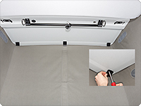 Three hook-and-loop fastener pads are fastened with two screws each to the front ceiling (ABS).